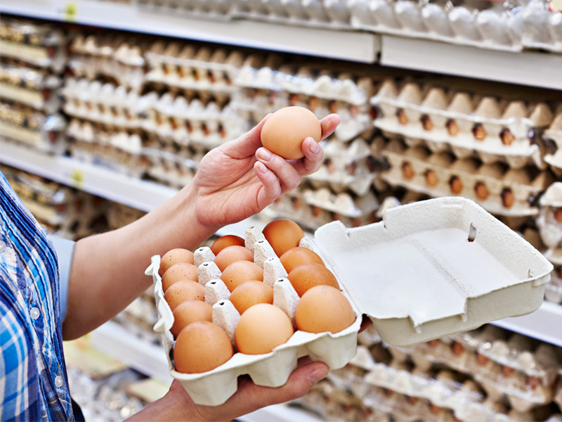 woman holding eggs at the store