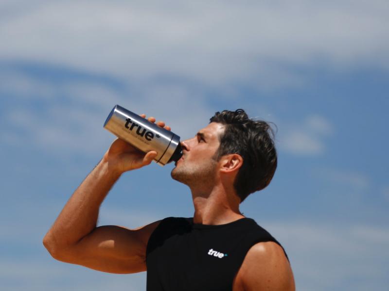 man drinking protein